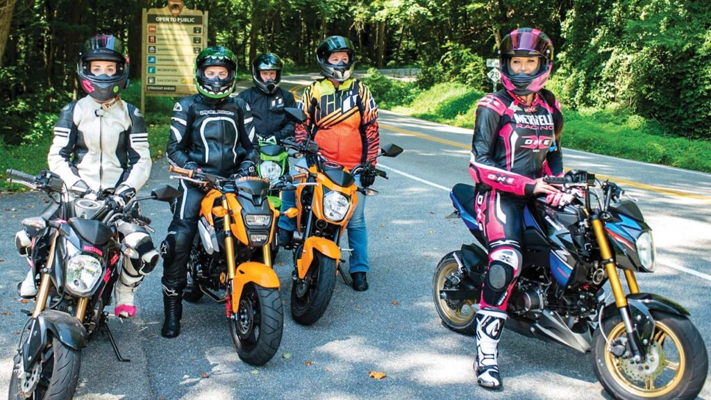 A colorful group of motorcycles and riders