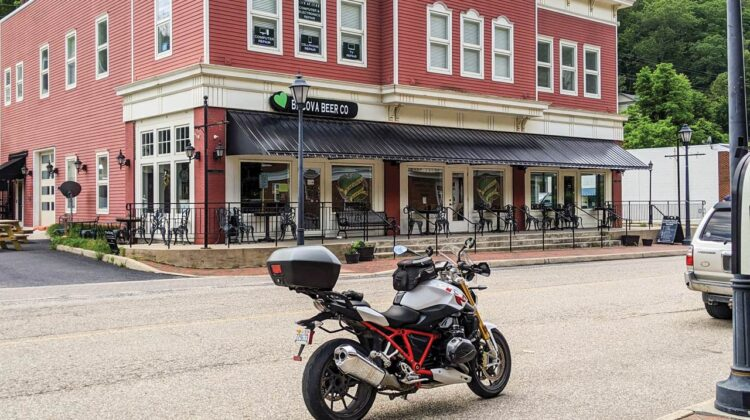 A motorcycle is parked on a quaint downtown street