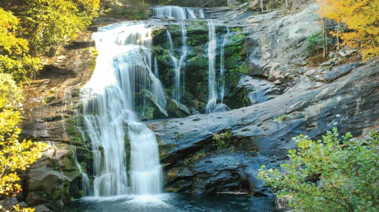 A waterfall surrounded by autumn foliage