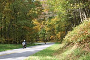 Two motorcyles wind their way down the Blue Ridge Parkway.