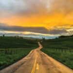 Sunset view of a narrow country road